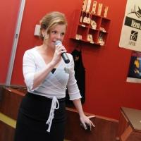 Monique Poirier announces the end of the silent auction.